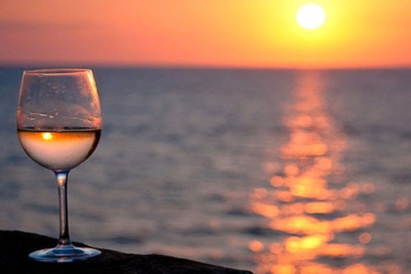Calice, sommelier, tramonto