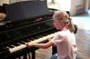 Musica, bambina, pianoforte